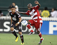 Andy Najar #14 of D.C. United watches Jair Benitez #5 of FC Dallas control the ball during an MLS match at RFK Stadium in Washington D.C. on August 14 2010. Dallas won 3-1.