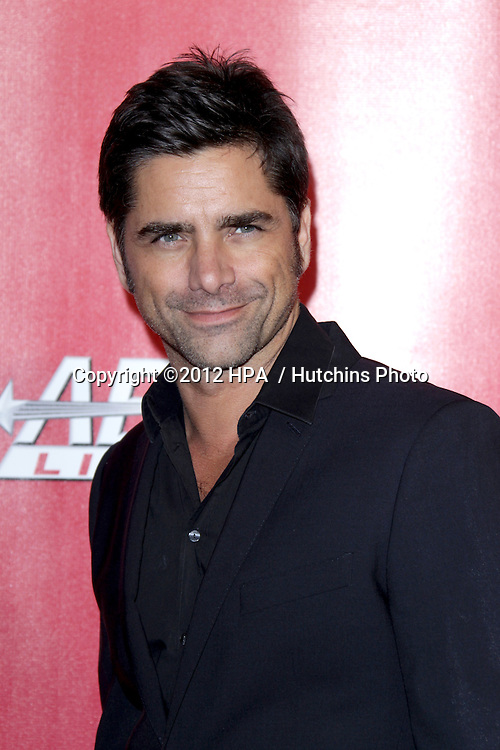 LOS ANGELES - FEB 10:  John Stamos arrives at the 2012 MusiCares Gala honoring Paul McCartney at LA Convention Center on February 10, 2012 in Los Angeles, CA