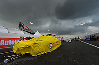 Sept. 1, 2012; Clermont, IN, USA: The car of NHRA pro stock driver Warren Johnson sits under a rain cover during a weather delay to qualifying for the US Nationals at Lucas Oil Raceway. Mandatory Credit: Mark J. Rebilas-