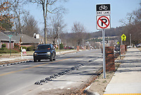 NWA Democrat-Gazette/FLIP PUTTHOFF <br /> Vehicles move Saturday March 16 2019 along Dick Smith Street in Springdale between barriers installed to create bike lanes on each side of the street.