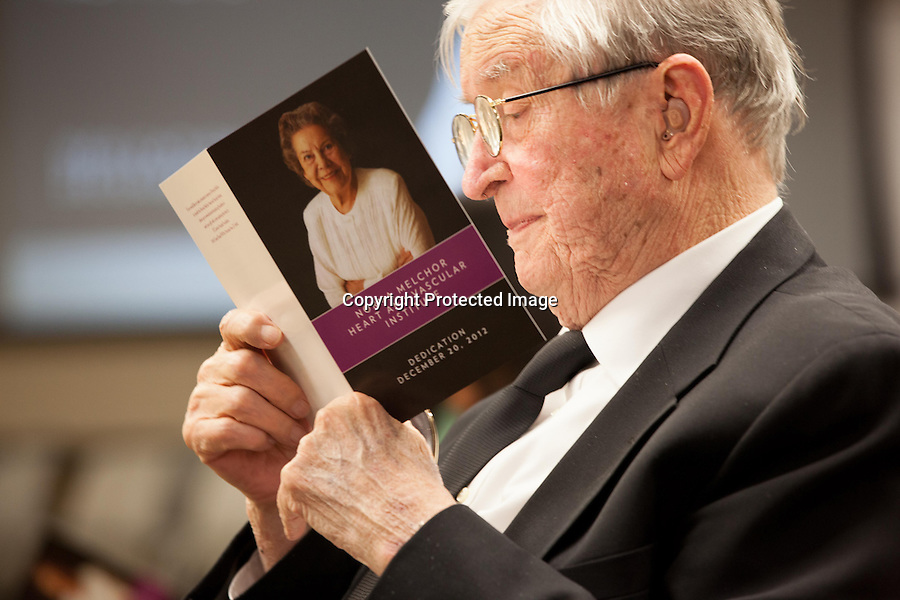 Jack Melchor reads a program before the dedication of a hospital program in honor of his wife, Norma Melchor. Melchor, a former surgical nurse and ardent supporter of the hospital for more than 50 years, died Feb. 17 at the age of 87.<br />