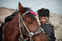 Mujaheed and his horse...Trekking with yak caravan through the Little Pamir where the Afghan Kyrgyz community live all year, on the borders of China, Tajikistan and Pakistan.
