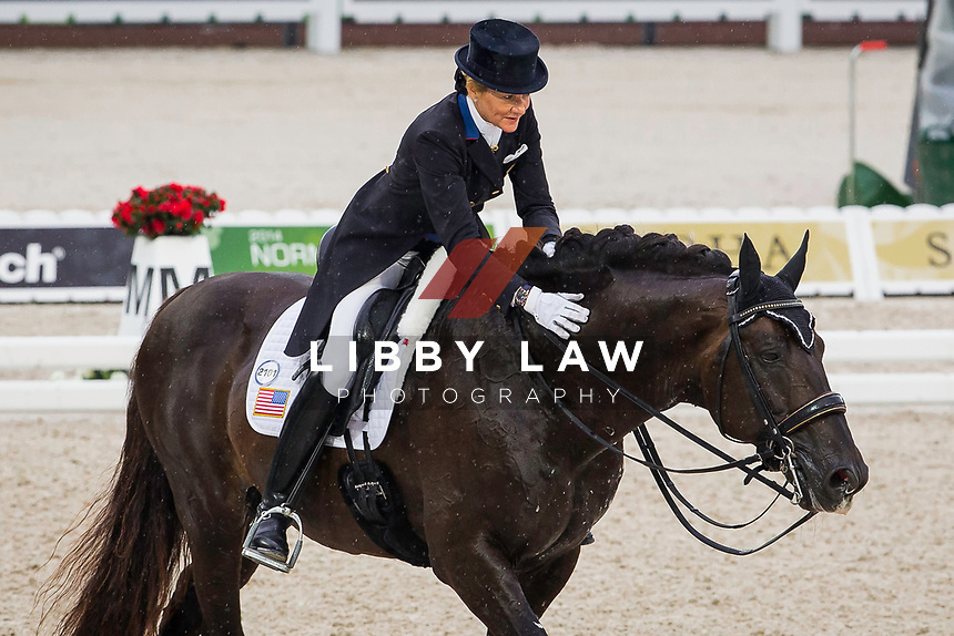 USA-Tina Konyot (CALECTO V) INTERIM-17TH: GRAND PRIX: Team Competition (Qualifier for the Grand Prix Special) The Alltech FEI World Equestrian Games 2014 In Normandy - France (Monday 25 August) CREDIT: Libby Law COPYRIGHT: LIBBY LAW PHOTOGRAPHY - NZL