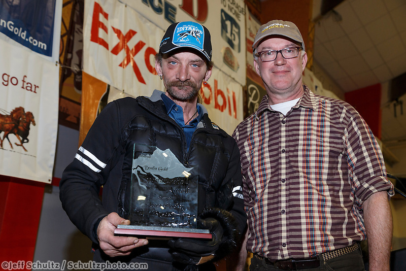 Lance Mackey (L) recieves the Donlin Gold sportsmanship award from Kurt Parkan at the finishers banquet in Nome on Sunday  March 22, 2015 during Iditarod 2015.  <br /> <br /> (C) Jeff Schultz/SchultzPhoto.com - ALL RIGHTS RESERVED<br />  DUPLICATION  PROHIBITED  WITHOUT  PERMISSION