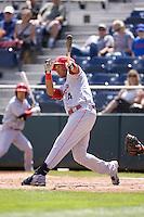 Spokane Indians' Smerling Lantigua #4 at bat during a game against the Everett AquaSox at Everett Memorial Stadium on June 24, 2012 in Everett, WA.  Spokane defeated Everett 11-2.  (Ronnie Allen/Four Seam Images)