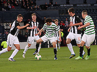 Bahrudin Atajic on the ball about to be tackled by Kerr Young in the Dunfermline Athletic v Celtic Scottish Football Association Youth Cup Final match played at Hampden Park, Glasgow on 1.5.13. ..