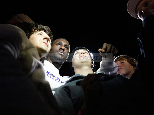 Patrick Patterson poses for a picture with Matt, left, and Elijah Jeffery outside Memorial Coliseum on Friday, October 2, 2009. Photo by Zach Brake