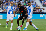 CD Leganes's Roque Mesa (L) and Youssef En-Nesyri (R) and Atletico de Madrid's Thomas Lemar during La Liga match between CD Leganes and Atletico de Madrid at Butarque Stadium in Madrid, Spain. August 25, 2019. (ALTERPHOTOS/A. Perez Meca)