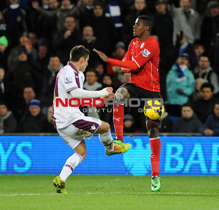 Cardiff City's Wilfred Zaha loses out to Aston Villa's Ashley Westwood -    11/02/2014 - SPORT - FOOTBALL - Cardiff - Cardiff City Stadium - Cardiff City v Aston Villa - Barclays Premier League<br /> Foto nph / Meredith<br /> <br /> ***** OUT OF UK *****