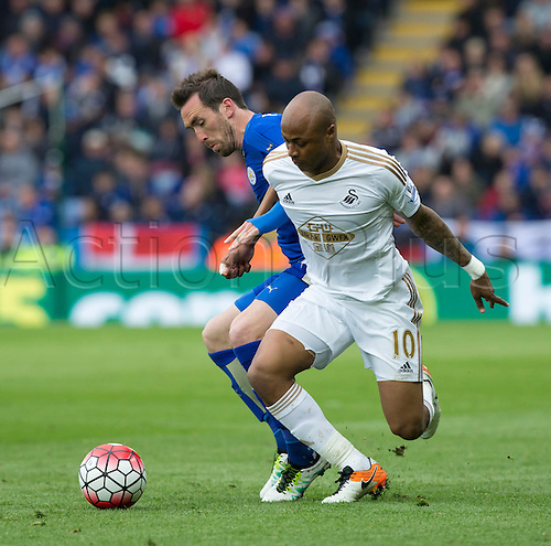 24.04.2016. King Power Stadium, Leicester, England. Barclays Premier League. Leicester versus Swansea. Swansea City striker Andre Ayew and Leicester City defender Christian Fuchs tussle for possession of the ball.