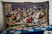 A small tapestry on the wall in Stoyanka's house depicting the story of a prince that comes on a white horse to save the woman he loves. Stoyanka was 14 when she had a dream that a boy is coming on a white horse with a bag filled with money to take her away from her parents. This is a well-known, traditional fairy tale, like Cinderella, that informs the dreams of every girl in the Tinsmith clan. This same tapestry can be seen in many of their houses, reflecting the traditional view of expected salvation in the form of a future husband. Ognianovo. He Came on a White Horse.