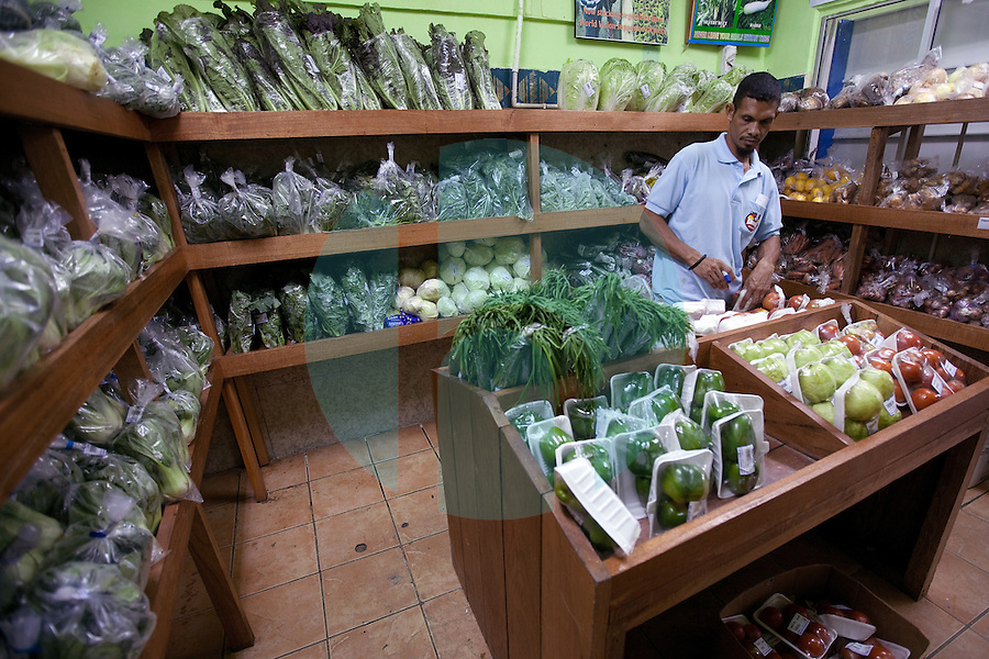 Shoppers in the Kmanek supermarket, which is located in the capital city of Dili, Timor-Leste on Wednesday, Oct. 12th, 2011.  Photographer: Daniel J. Groshong/The Hummingfish Foundation