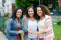 From left, Cherjon Overton of Deptford, New Jersey, Sally Armstrong of Dallas, Texas and Sterling Overton-Crawford of Fredericksburg, Virginia show their matching sister bracelets Saturday, May 19, 2018 in Philadelphia, Pennsylvania. Sally Armstrong used a 23andMe Health + Ancestry kit to find her four half siblings. She met them for the first time Friday. (Photo by William Thomas Cain/CAIN IMAGES)
