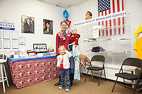Tracy Endorf and her two children volunteer at the Mitt Romney campaign office on the day of the U.S. presidential election in Milwaukee, Wisconsin November 6, 2012. REUTERS/Sara Stathas (UNITED STATES)