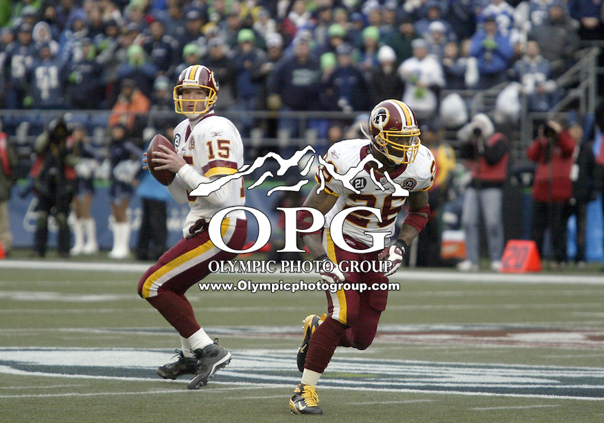 January 05, 2008:  Washington Redskins quarterback #15 Todd Collins waits for running back #26 Clinton Portis to finish his route before passing the ball to him against the Seattle Seahawks at Quest Field in Seattle, WA.  Seattle won 35-14 over the Washington Redskins.