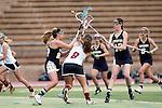 San Diego, CA 04/19/10 - Anna Knowles (Torrey Pines #8), Megan Lax (La Costa Canyon #13) and Sara Nolte (La Costa Canyon #22) in action during the Torrey Pines-La Costa Canyon Girls Lacrosse game at Torrey Pines.