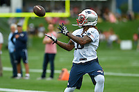 July 24, 2014 - Foxborough, Massachusetts, U.S.- New England Patriots running back Brandon Bolden (38) gets his hands under the ball to make a catch during the New England Patriots training camp held at Gillette Stadium in Foxborough Massachusetts. Eric Canha/CSM