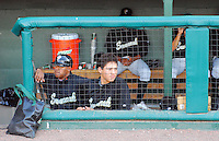 April 30, 2009: Infielder and Mets No. 2 prospect Wilmer Flores, right, of the Savannah Sand Gnats, looks out of the dugout just before the start of a game at Fluor Field at the West End in Greenville, S.C. At left is coach Jose Carreno. Photo by: Tom Priddy/Four Seam Images