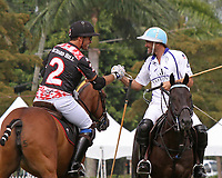 WELLINGTON, FL - APRIL 25:  Adolfo Cambiaso of Vaniente (white jersey) and Juan Jota Chavanne of Orchard Hill (black jersey) exchange pleasantries before the start of the match. Scenes from the US Open Polo Championship Final, at the International Polo Club Palm Beach, on April 25, 2017 in Wellington, Florida. (Photo by Liz Lamont/Eclipse Sportswire/Getty Images)