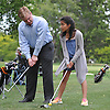 Sean Sage, Assistant General Manager at Lawrence Yacht and Country Club, Jeymi Diaz, 11, of Inwood with her golf swing at the club's driving range on Tuesday, June 7, 2016.