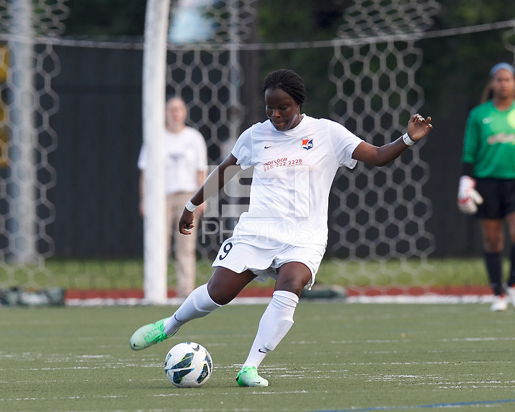 Sky Blue FC forward Danesha Adams (9) clears the ball.  In a National Women's Soccer League (NWSL) match, Boston Breakers (blue) defeated Sky Blue FC (white), 3-2, at Dilboy Stadium on June 30, 2013.