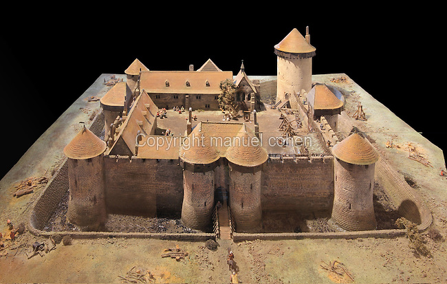 Model of the Chateau de Dourdan as it would originally have looked, in the castle museum, Chateau de Dourdan, Dourdan, Hurepoix, Essonne, France. The castle was built 1220-22 by Guillaume de Flamenville under Philippe Auguste, replacing an earlier wooden structure. It is built on a square plan, with towers along the sides, at 3 of the corners and an isolated donjon at the 4th, and is surrounded by a dry moat. From 1672-1852 it became a prison, and now houses a history museum. The castle became an Historical Monument in 1964. Picture by Manuel Cohen
