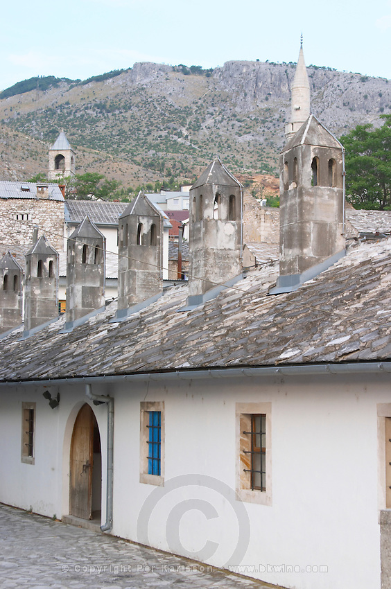 An old ottoman house with typical roof stone slate tiles and stone chimneys. Historic town of Mostar. Federation Bosne i Hercegovine. Bosnia Herzegovina, Europe.