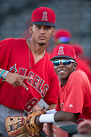 AZL Angels infielders Jeremiah Jackson (8) and Daniel Ozoria (23) pose for a photo before an Arizona League game against the AZL Padres 2 at Tempe Diablo Stadium on July 18, 2018 in Tempe, Arizona. The AZL Padres 2 defeated the AZL Angels 8-1. (Zachary Lucy/Four Seam Images)