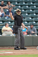 Home plate umpire Tom Hanahan makes a strike call during the Carolina League game between the Myrtle Beach Pelicans and the Winston-Salem Dash at BB&T Ballpark on May 11, 2017 in Winston-Salem, North Carolina.  The Pelicans defeated the Dash 9-7.  (Brian Westerholt/Four Seam Images)