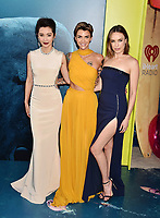 HOLLYWOOD, CA - AUGUST 06: (L-R) Li BingBing, Ruby Rose and Jessica McNamee attend the premiere of Warner Bros. Pictures and Gravity Pictures' Premiere of 'The Meg' at the TLC Chinese Theatre on August 06, 2018 in Hollywood, California.<br /> CAP/ROT/TM<br /> &copy;TM/ROT/Capital Pictures
