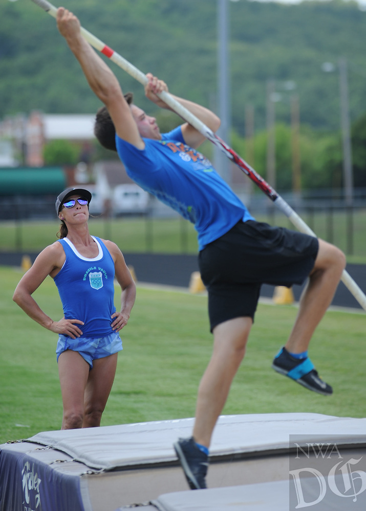 NWA Democrat-Gazette/ANDY SHUPE<br /> Stacy Dragila (left), a former Olympic pole vaulter and 2000 Olympic gold medalist, watches Friday, June 16, 2017, as Cole Cripps of Gentry vaults during instruction for pole vaulters at Ramay Junior High School in Fayetteville. Dragila and April Steiner Bennett, a former Arkansas and Olympic pole vaulter, were on hand for two days of intensive instruction for vaulters from elementary to high school.