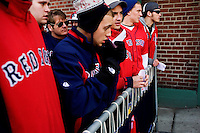 Fans who stayed overnight outside Fenway Park wait in line to get game-day tickets for the 2011 season opener of the Boston Red Sox in Boston, Massachusetts, USA.