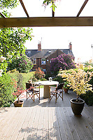 A sun deck has been constructed at the far end of the sunny rear garden with a garden table and chairs