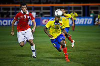 Ecuador's player Cristian Benitez ( R) fights for the ball against Chile's player Marco Gonzalez during their friendly match at the Citi-Field Stadium in New York, August 15, 2012. Photo by Eduardo Munoz Alvarez / VIEW.