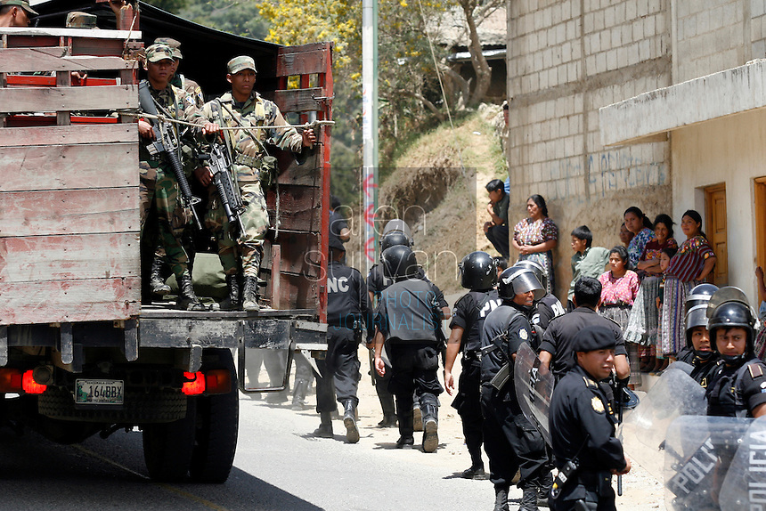 Police and soldiers pack up after indigenous people demonstrated against U.S. President Bush in Tecpán Guatemala, Guatemala. Bush visited a nearby Mayan site, Iximché.