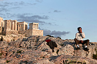 Pictured: A lone tourist rests on the rock of Areios Pagos next to the Acropolis.<br /> Re: Police patrol the streets to enforce the measures of self-isolation in an effort to fight the Coronavirus Covid-19 pandemic in Athens, Greece.
