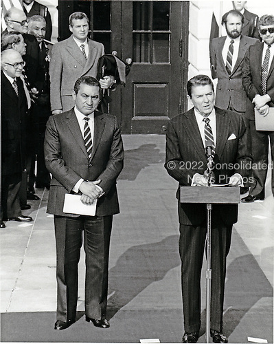 United States President Ronald Reagan and President Hosni Mubarak of Egypt make statements after meeting at the White House in Washington, D.C. on January 27, 1983.  The met to discuss topics of mutual interest to the United States and Egypt..Credit: Howard L. Sachs / CNP