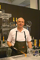 An ice bar with champagne coolers in pure ice. At Vinordic. The ice sculptor. At the Vinordic wine trade show. Stockholm. Sweden, Europe.