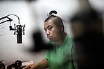 BANGKOK. THAILAND JAN 2015:<br />Kapol Thongplub, a ghost tycoon listen to a young woman telling her story on meeting a ghost, during his Ghost radio show in Bangkok, Jan 2015<br />@Giulio Di Sturco for the NewYorkTimes International