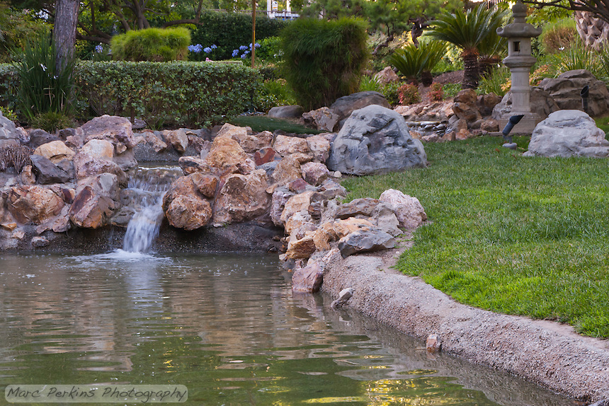 The wedding was held at the Langham Hotel in Pasadena.  Their grounds were beautiful, and included this cascading water feature inside an asian-themed garden.  Very nice to wander around in after the wedding.