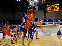 Steve Adams and Casey Frank cancel Sharks import Sylvetser Spicer's layup attempt. NBL - Wellington Saints v Southland Sharks at TSB Bank Arena, Wellington, New Zealand on Friday, 22 April 2011. Photo: Dave Lintott / lintottphoto.co.nz