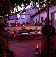 The terrace looks romantic at dusk when lit by candlelight