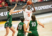 COLLEGE PARK, MD - DECEMBER 8: Ashley Owusu #15 of Maryland shoots over the Loyola defense during a game between Loyola University and University of Maryland at Xfinity Center on December 8, 2019 in College Park, Maryland.