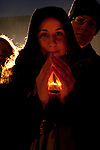 An young woman takes part in the Candle light vigil held with Bishop Tutu at the Bella Center. (Images free for Editorial Web usage for Fresh Air Participants during COP 15. Credit: Robert vanWaarden)