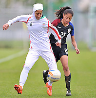 Monfalcone, Italy, April 26, 2016.<br /> USA's #21 Mendoza (R) fights for the ball with Itan's #8 Hosseini during USA v Iran football match at Gradisca Tournament of Nations (women's tournament). Monfalcone's stadium.<br /> &copy; ph Simone Ferraro / Isiphotos