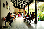 Patients wait inside a public health clinic in Suchitoto, El Salvador.  The clinic  charges $2 for patient visits...