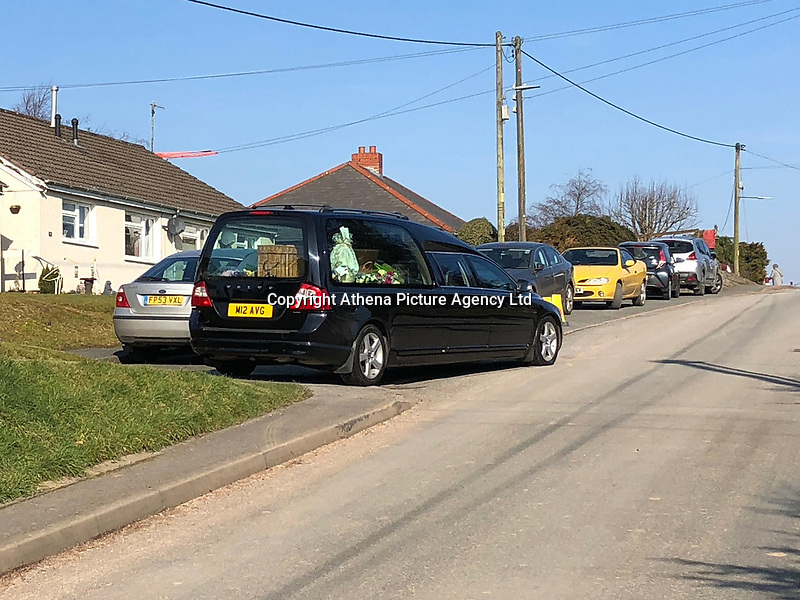 "Pictured: One of the hearses leaving St Cadmarch's Church. Saturday 24 February 2018<br /> Re: The funeral of David Cuthbertson and his five children who died in a house fire in Llangammarch Wells, Powys, will take place at St Cadmarch's Church, on Saturday 24 February 2018.<br /> 68 year old David Cuthbertson, 68, died in the fire in October along with children Gypsy Grey Raine, 4, Patch Raine, 6, Misty Raine, 9, Reef Raine, 10, and Just Raine, 11.<br /> Three other children escaped the fire. The cause is being treated as unexplained.<br /> Dyfed Powys Police previously said an operation to dismantle about tonnes of bricks and mortar from the gutted house was being done ""brick by brick"" so that evidence is preserved."