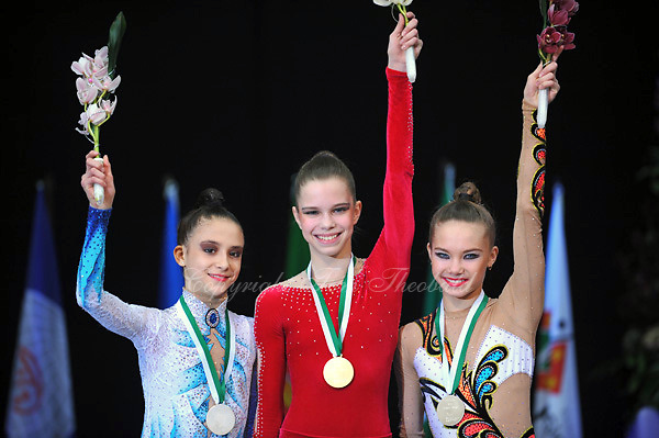 Junior gymnasts (L-R) (wait id) of Germany, Nataliya Leshchyk of Belarus, Adel Galina of Russia celebrate Event Finals medals at 2010 World Cup at Portimao, Portugal on March 13, 2010.  (Photo by Tom Theobald).