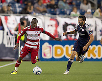 FC Dallas defender Jair Benitez (5) brings the ball forward as New England Revolution midfielder Monsef Zerka (19) closes.  In a Major League Soccer (MLS) match, the New England Revolution defeated FC Dallas, 2-0, at Gillette Stadium on September 10, 2011.
