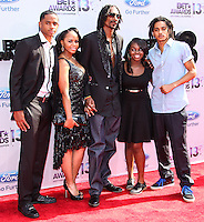 LOS ANGELES, CA - JUNE 30: Snoop Dogg aka Snoop Lion, wife Shante Taylor and children Corde Broadus, Cordell Broadus and Cori Broadus attend the 2013 BET Awards at Nokia Theatre L.A. Live on June 30, 2013 in Los Angeles, California. (Photo by Celebrity Monitor)
